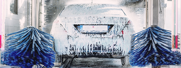 Image of silver car going through automatic car wash