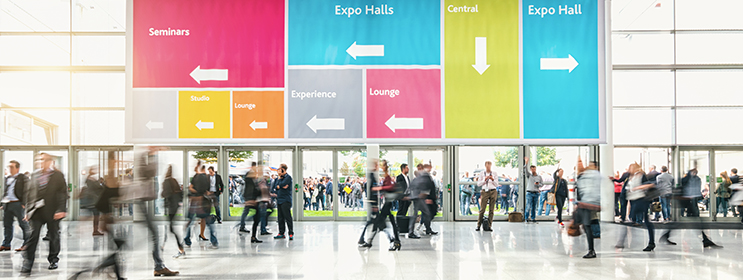 image of people walking inside the lobby of a trade show event