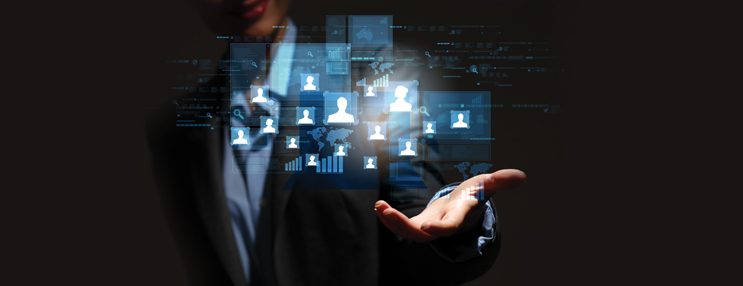 image of man in suit on black background with people icons floating in air over hand depicting software technology solutions