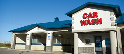 Image of the exterior front face of a commercial car wash business