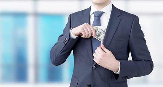 image of man in suit putting money into the inside chest pocket of his jacket