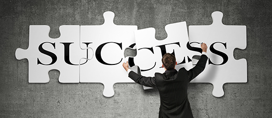 image of man putting together puzzle pieces that spell success