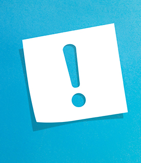 image of white paper with exclamation point cut out on blue background