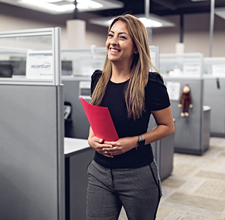 photo of smiling woman walking down hallway at work